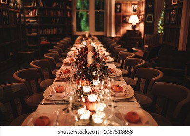 A beautiful table setting for Thanksgiving dinner in a restaurant. Private dining. Horizontal image, indoors, selective focus.