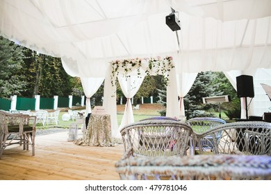 beautiful tables and chairs prepared for a young couple and guests