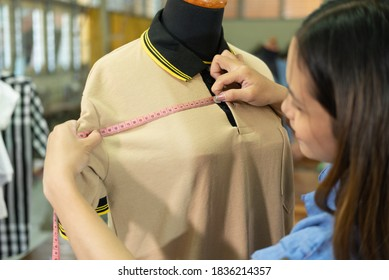 beautiful tailor women measure chest width with tape measure at the clothing garment room