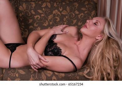 Beautiful tall blonde dressed in black lingerie