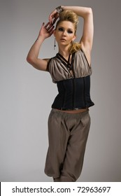 Beautiful tall blonde in a vest and loose pants