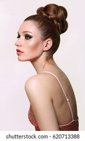 A beautiful tall, three-dimensional hairstyle gathered at the top of the head. . Girl with long hair. Straightening of keratin. Hair care. Beauty saloon. Hair care, spa. Retro. Bright makeup.