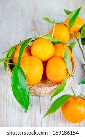 beautiful tangerines on a light wooden table