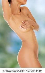 Beautiful tanned slim female body.