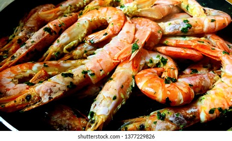 beautiful tasty appetizing roasted shrimps prawns with spices on pan close up
