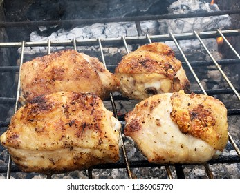 Beautiful tasty food from slice grilled chicken meats, roast on metal brazier. Meat of bird with crispy crust fried in the brazier. Chicken meat preparation for cooking barbecue in brazier on fire.