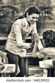Beautiful teacher with mixed race classroom.