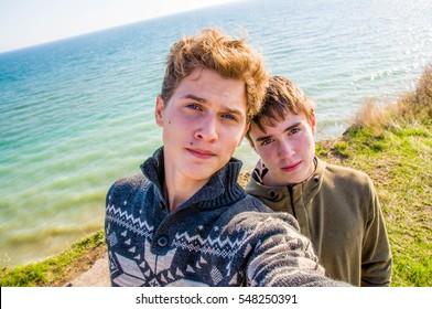 Beautiful teen boys selfies outdoors