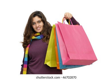 Beautiful teen with colorful bags isolated in white