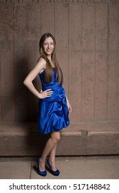 Beautiful teen girl in blue dress
