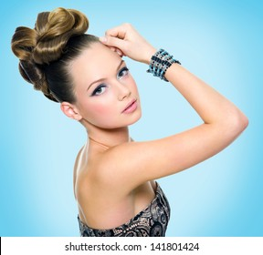 Beautiful teen girl with curly hairstyle and bright makeup - on white background