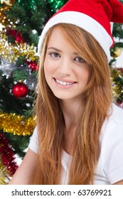 beautiful teen girl in front of a Christmas tree