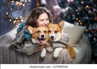 beautiful teen girl hugging dogs at christmas time