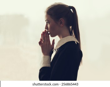 beautiful teen girl praying