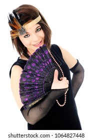 """A beautiful teen girl roaring 20s """"flapper,"""" smiling over her hand-held fan.  On a white background."""