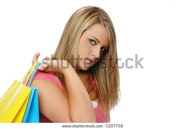 Beautiful teen girl shopping isolated on a white background