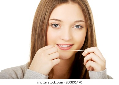 Beautiful teen woman with dental floss.