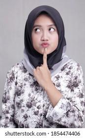 Beautiful teenage female model wearing a modern hijab, Muslim woman on a gray background. The concept of a stylish Muslim hijab fashion lifestyle portrait. pringsewu, lampung, indonesia. 13 june 2018