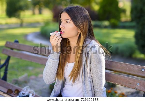 Beautiful teenage girl with chapstick on her lips