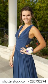 Beautiful Teenage Girl in her Prom Dress Outdoors