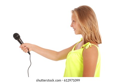 Beautiful teenage girl with microphone isolated on white background