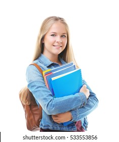Beautiful teenager with backpack and books on white background