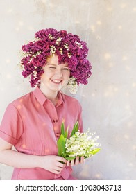 beautiful teenager girl with lilac and lily of valey