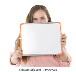 A beautiful teenager is holding a white board and smiling.