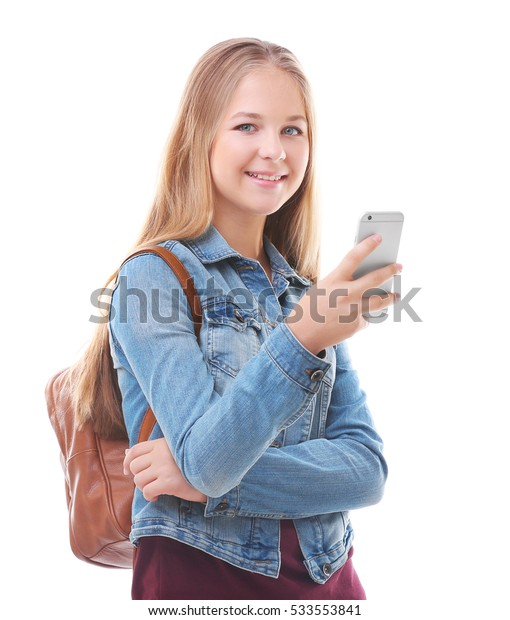 Beautiful teenager with smart phone on white background