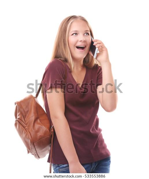 Beautiful teenager talking on smart phone on white background