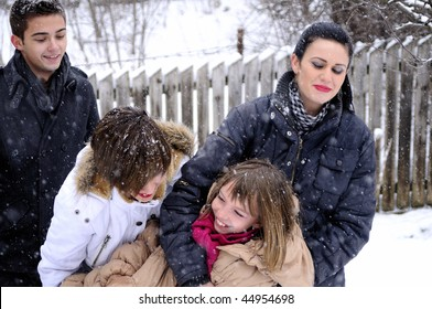 beautiful teens playing with snow