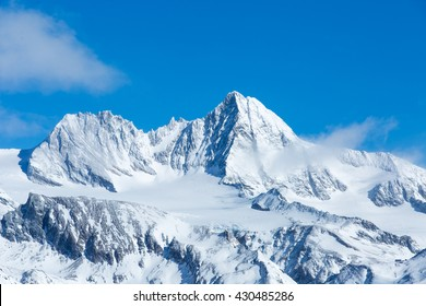 Beautiful telephoto shot of Austria's highest mountain, the Grossglockner, on a sunny winter day.