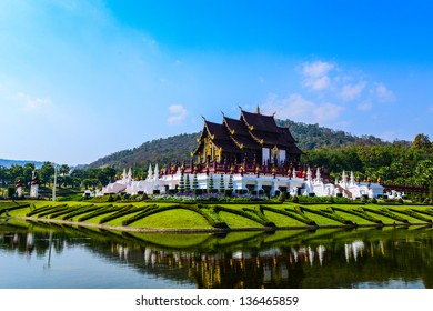 Beautiful temple Lanna or Thai style with lake on bule sky.