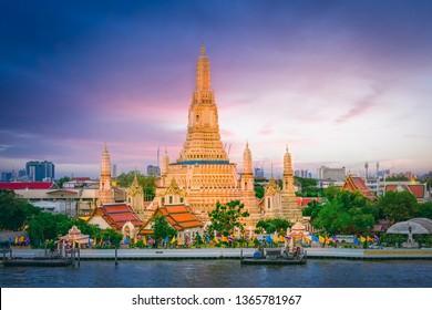 Beautiful temple Wat arun ratchawararam with Chaophaya river landmark in Bangkok city Thailand.
