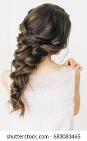 Beautiful tender wedding hairstyle. Long braid hair.