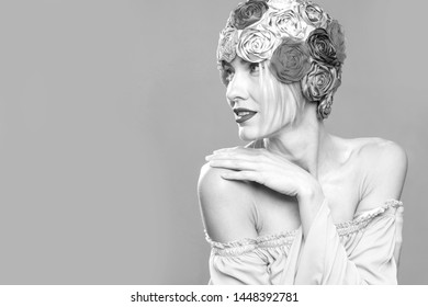 Beautiful tender woman with smooth skin. Fashion retro woman concept