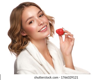 Beautiful tender young girl in a white coat with clean fresh skin posing in front of the camera. Beauty face. Skin care. Photo taken in studio on a white isolate background.