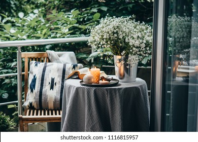 Beautiful terrace or balcony with small table, candles and flowers