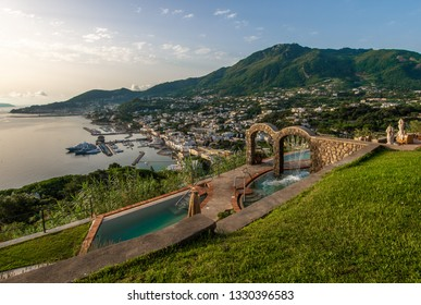 Beautiful terrace with green grass, thermal pools and views of the sea, Lacco Ameno and Mount Epomeo.
