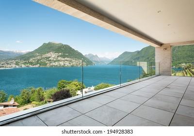 beautiful terrace in a modern penthouse, lake view