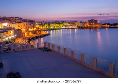 A beautiful terrace on the sea at sunset in Vieste, Puglia, Italy