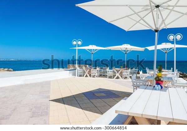 Beautiful terrace with sea view. Malia beach, Crete island, Greece.