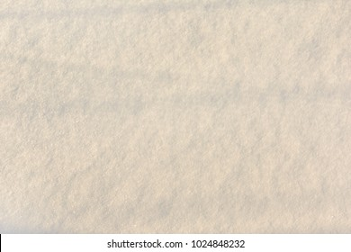 Beautiful texture of fresh snow. Empty light background. Place for text.