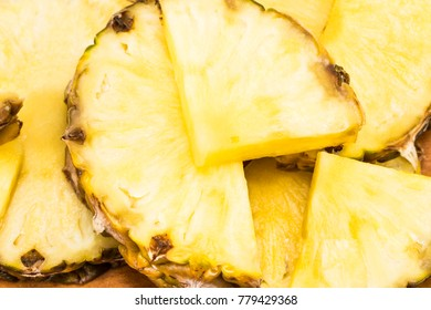 Beautiful texture slices of pineapple fruit close-up.