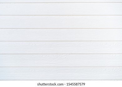 Beautiful texture of wooden wall background, painted in white color. wooden background.