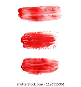 Beautiful textured red strokes of liquid lipstick or lip gloss, isolated on white background.