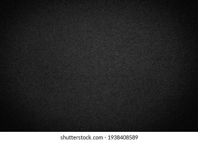 Beautiful textured sand black background. Blank for design.