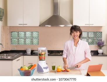 Beautiful Thai girl preparing food with modern style kitchen background