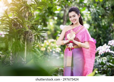 Beautiful Thai girl in Thai traditional costume