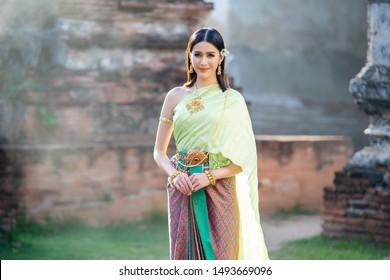 Beautiful Thai Girl in Traditional Dress Costume,Woman in Thai traditional dress at temple.